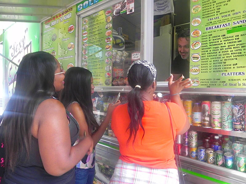 Students Ask Food Truck Worker How They Get Power for Sexy Green