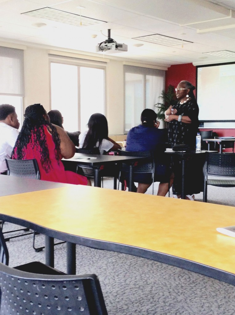 Temple University Professor Joyce Joyce discussing African-American poetry with youth.